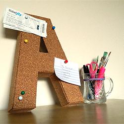 cork board covered cardboard letter