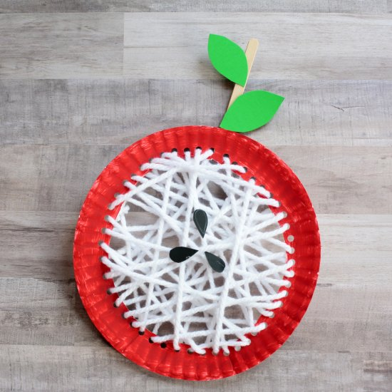 Yarn and paper plate core apple