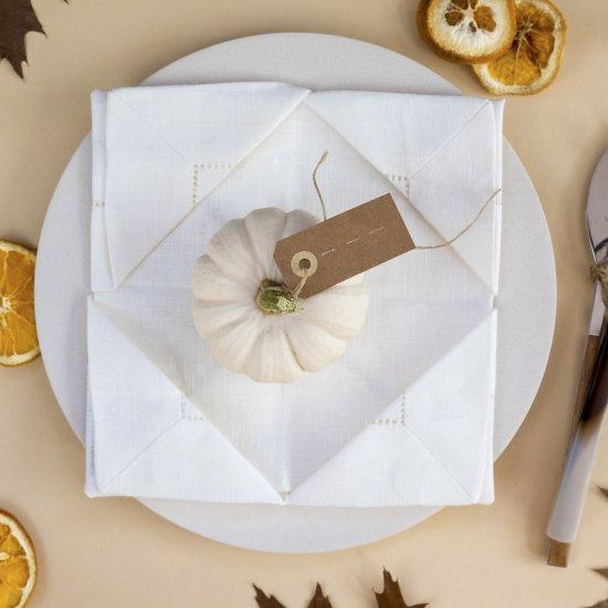 Fold your napkin for autumn.